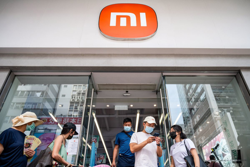Shoppers are seen leaving the Chinese multinational...